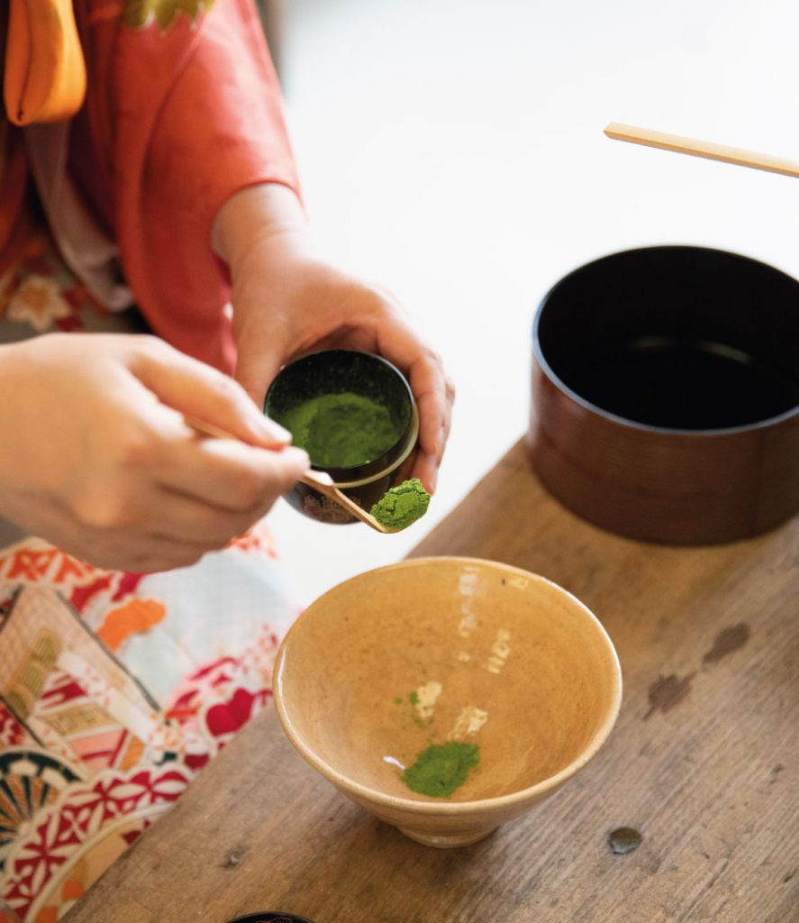 Scooping Matcha with a chashaku for a tea ceremony