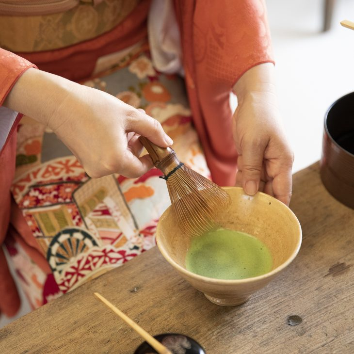 A cup of matcha being made during a tea ceremony